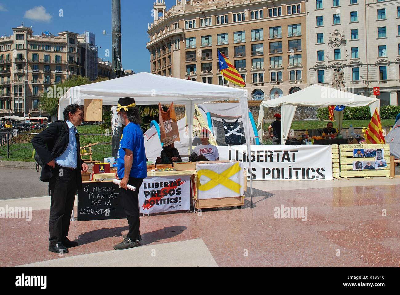 Campaigners for the Llibertat Presos Politics (Free Political Prisoners) movement campaign in Placa Catalunya in Barcelona, Spain on April 17, 2018. Stock Photo