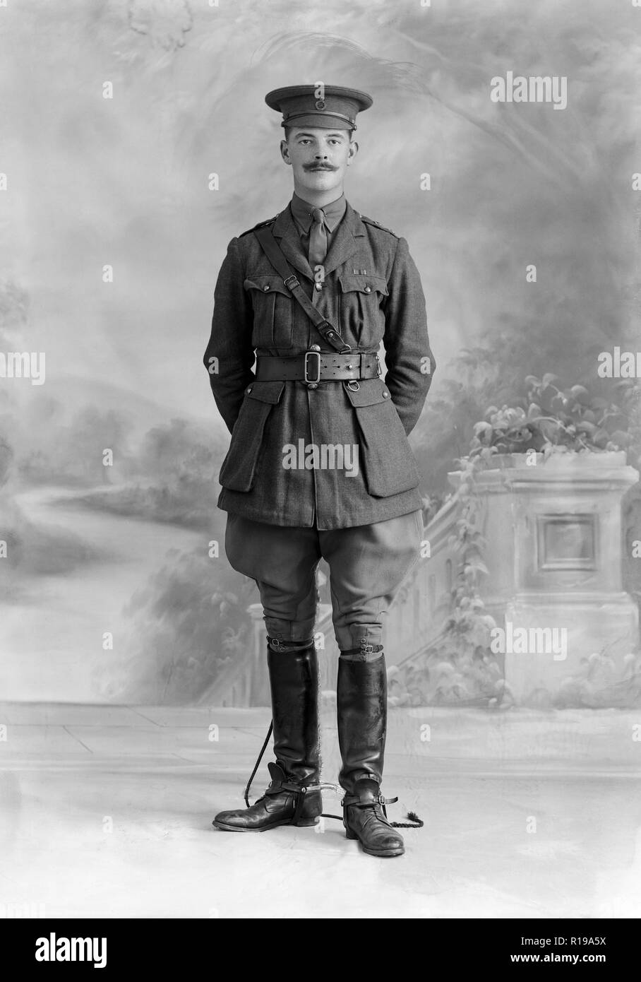 Lieutenant H. C. S. Combe of the Life Guards, a British Army regiment. Vintage black and white photograph taken during World War I in the famous Bassano studio in London. Lt. Combe is holding a horse whip whilst posing. - Stock Image