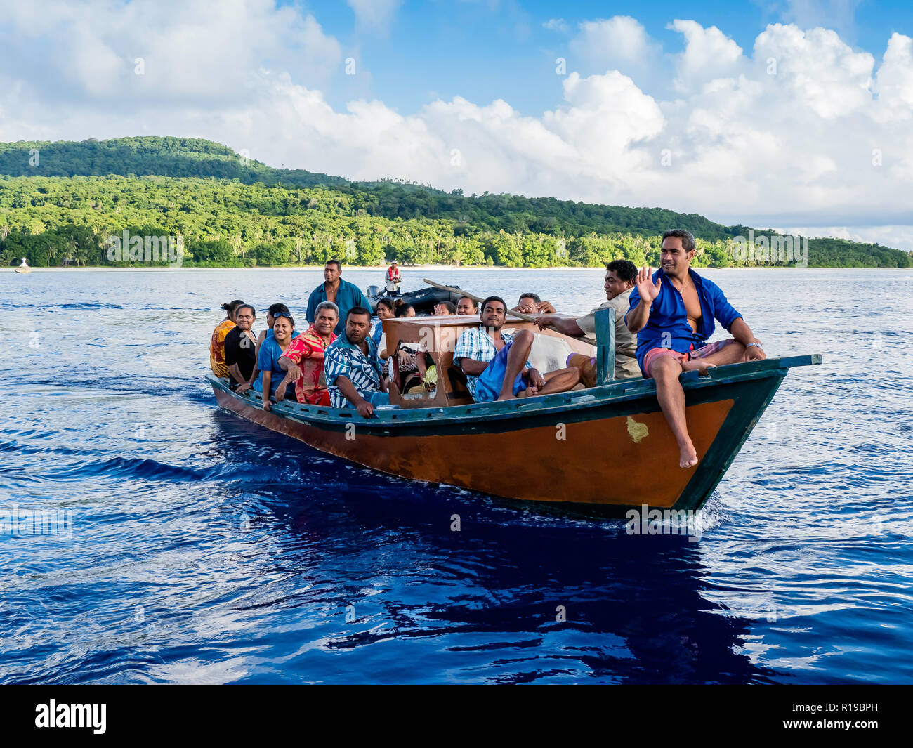 Local people in wooden boat from the Island of Alofi, French Territory of Wallis and Futuna Islands. - Stock Image