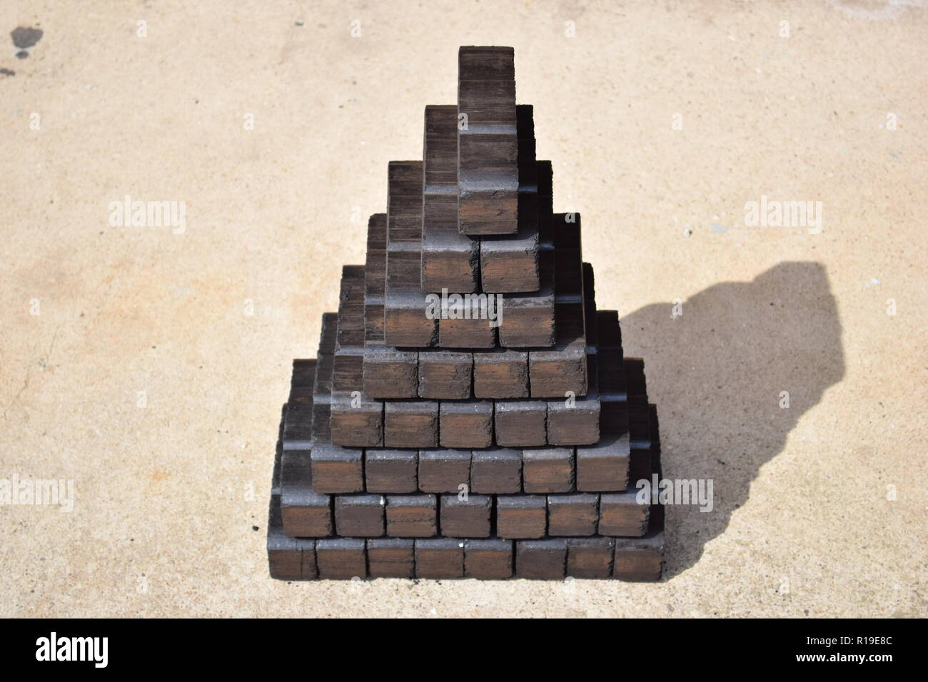 Brown coal briquette stockpile as an alternate heating source for fireplace or even for an solid fuel oven heating the whole house. - Stock Image