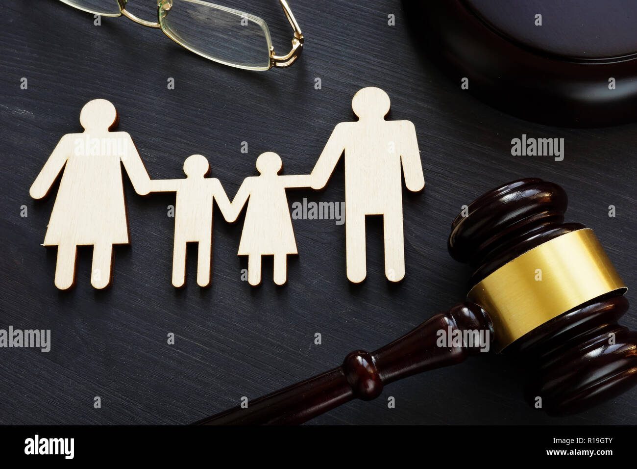Family law concept. Figures and gavel. Divorce. - Stock Image