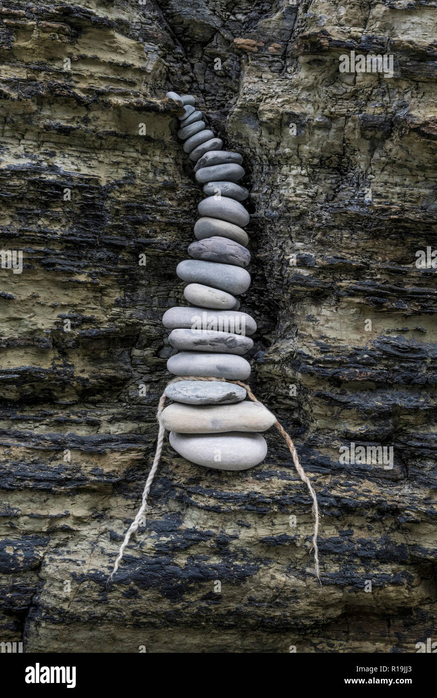 Zen inspired stone stacking in crevice, Birsay, Orkney - Stock Image