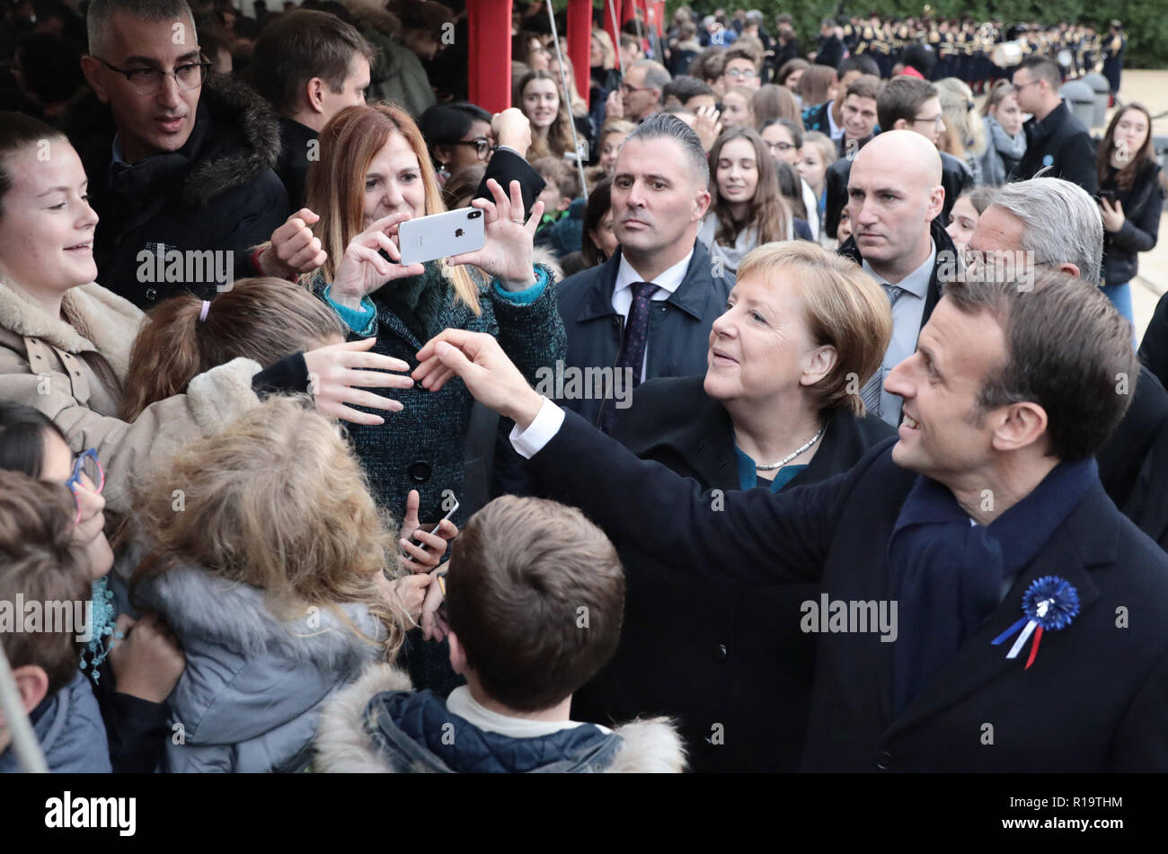 Compiegne, France. 10th Nov, 2018. German Chancellor Angela Merkel (CDU) and French President Emmanuel Macron meet with schoolchildren at the end of the First World War 100 years ago near the northern French town of Compiègne in memory of their memory. The armistice was signed on 11 November 1918 in a converted dining car in the clearing. The memorial is located on this site. Credit: Kay Nietfeld/dpa/Alamy Live News - Stock Image