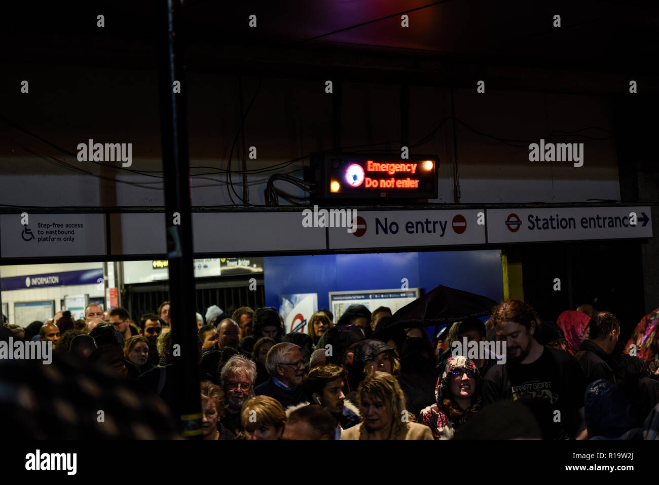 Tower Hill, London, UK. Adding to the crowd congestion due to the Beyond the Deepening Shadow event at the Tower of London, Tower Hill underground station has been closed due to an emergency - Stock Image