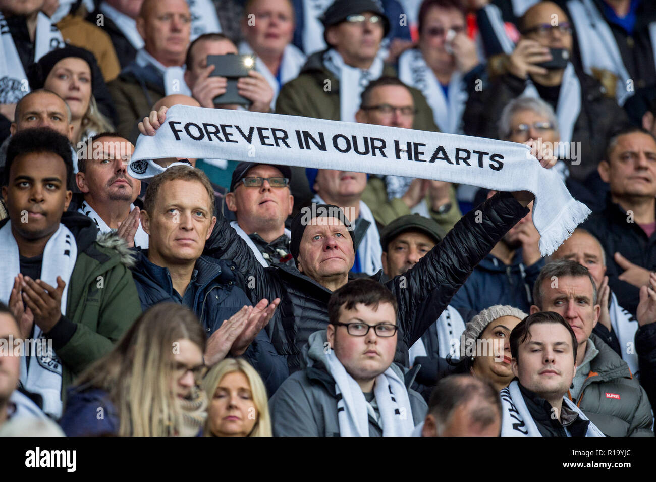 Leicester, UK. 10th Nov, 2018. A tearful Leicester fan holds up his scarf during the 2 minutes silence before the Premier League match between Leicester City and Burnley at the King Power Stadium, Leicester, England on 10 November 2018. Photo by Matthew Buchan.  Editorial use only, license required for commercial use. No use in betting, games or a single club/league/player publications. Credit: UK Sports Pics Ltd/Alamy Live News - Stock Image