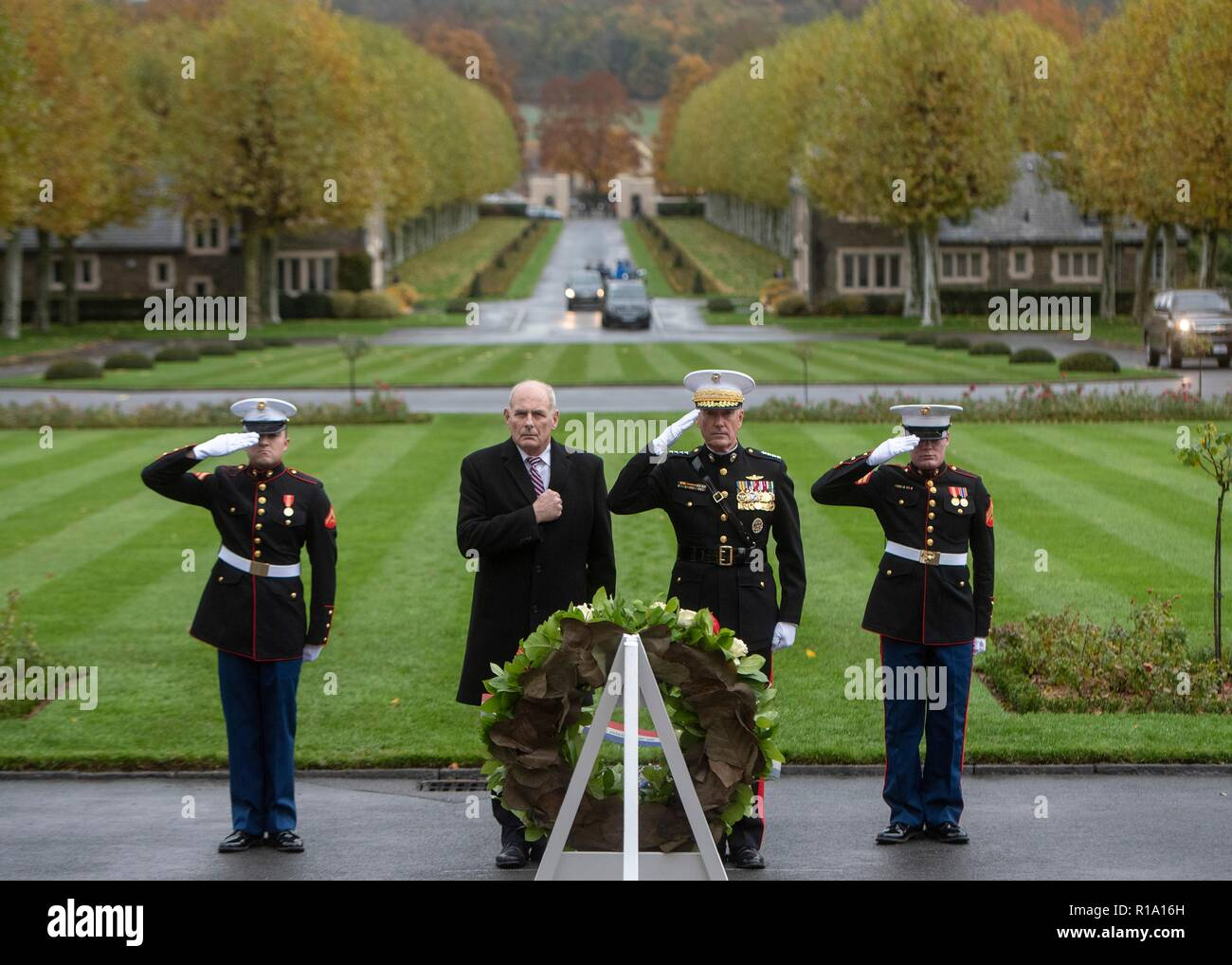 Belleau Wood, France. 10th Nov, 2018. U.S Joint Chiefs Chairman Gen. Joseph Dunford, right, walks with White House Chief of Staff John Kelly, left, salute during a ceremony at the Aisne - Marne American Cemetery near the World War One battle ground of Belleau Wood November 10, 2018 in Belleau, France. President Donald Trump was scheduled to attend the ceremony but cancelled due to inclement weather. Credit: Planetpix/Alamy Live News Stock Photo