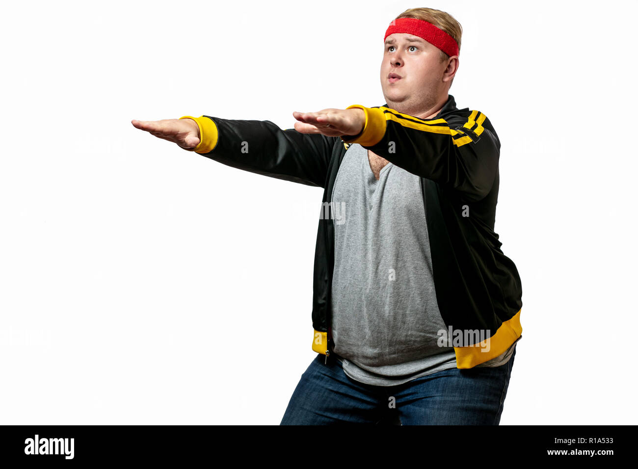 Overweight man resting, tired after training, with hand on forehead against white - Stock Image