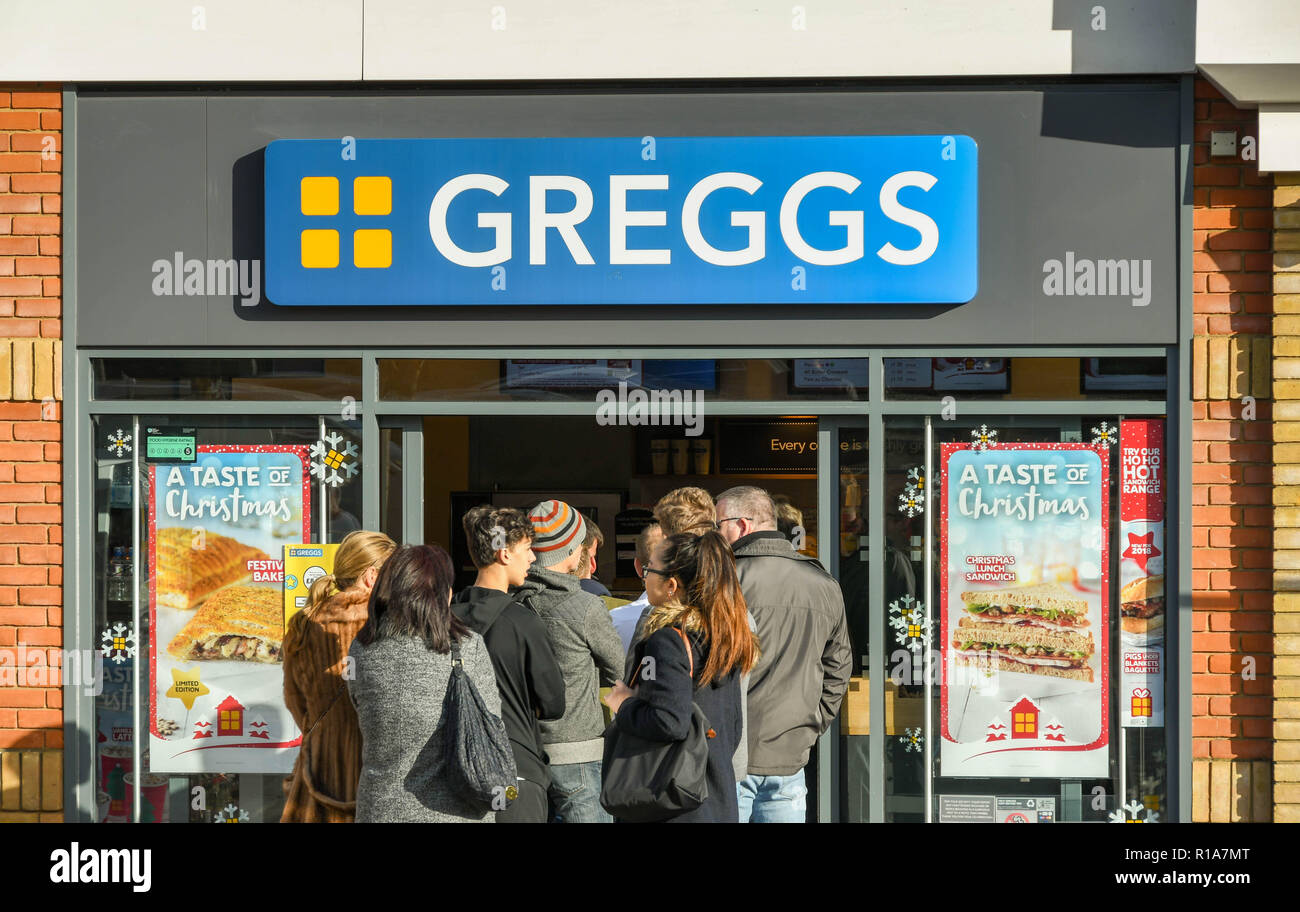 M4 SERVICES, READING, ENGLAND - NOVEMBER 2018: Customers queuing outside the door at the popular branch of Greggs bakery at the service station on the - Stock Image