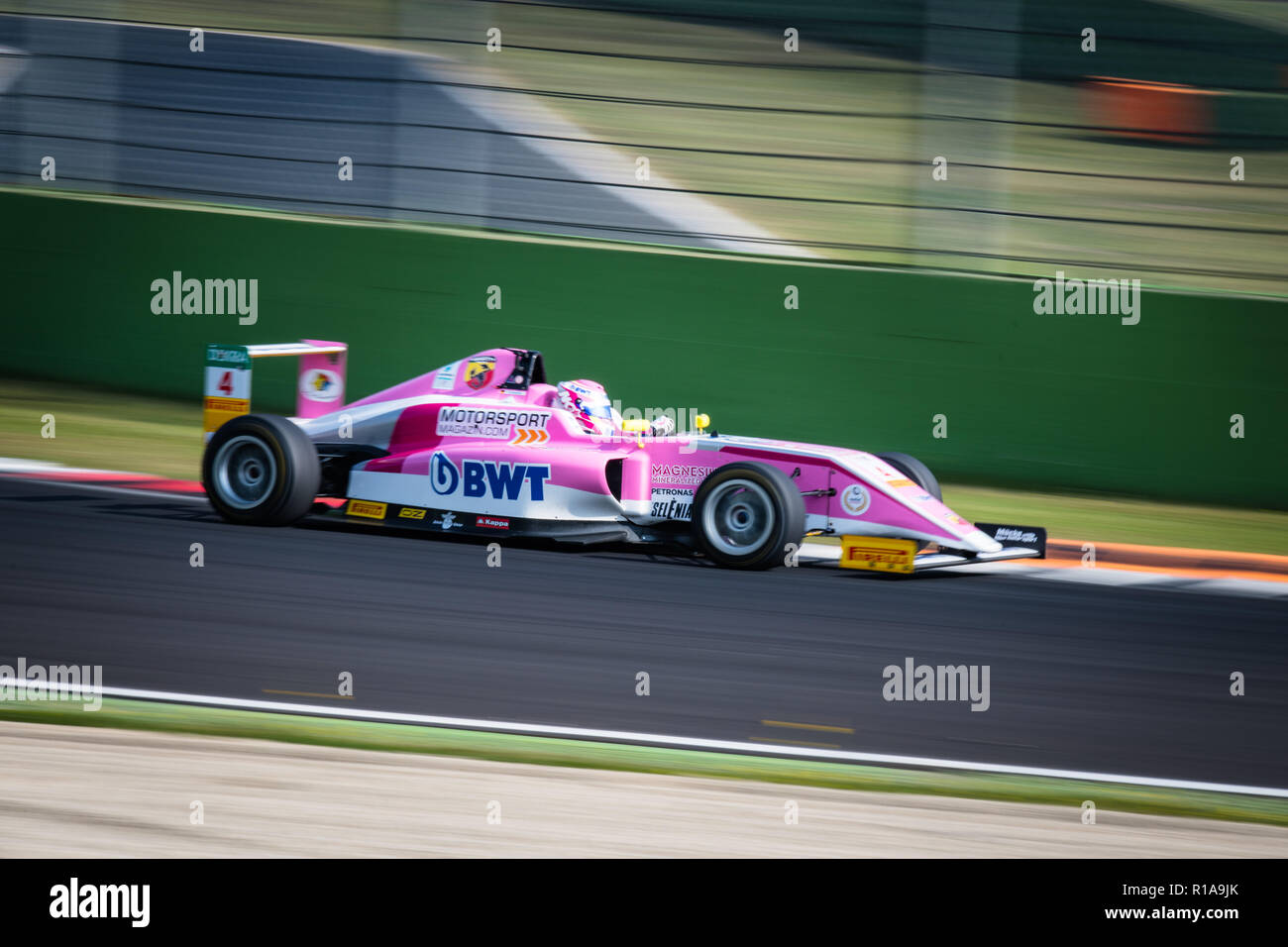 Vallelunga, Rome, Italy september 16 2018, Aci racing weekend. Formula 4 racing pink car at turn during the race, blurred motion background Stock Photo