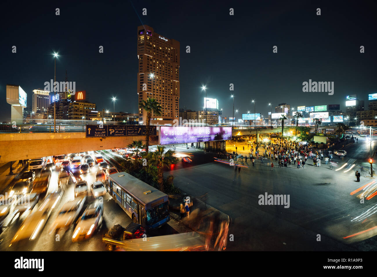 Cairo, Egypt - November 8, 2018: The busy Abdel Munim Riad square and bus station in central Cairo at night. - Stock Image