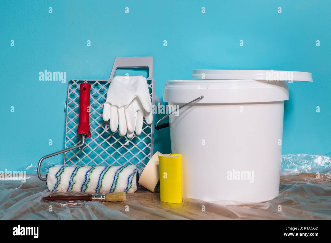 Image Of Man Holding Paint Roller And Equipment For Painting Wall