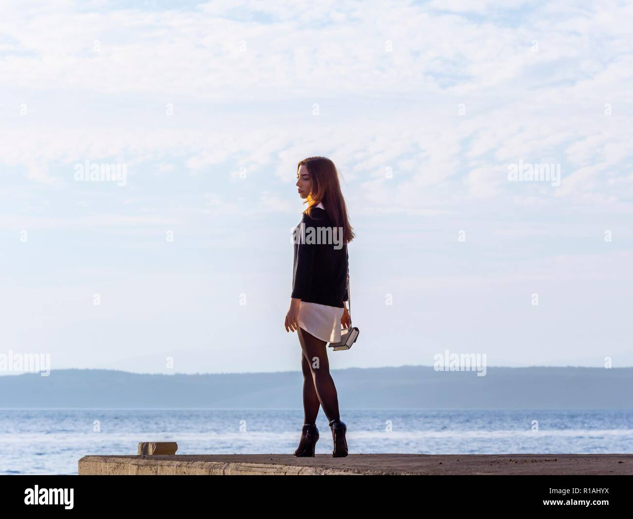 Walking teen girl outside full length side view profile Stock Photo