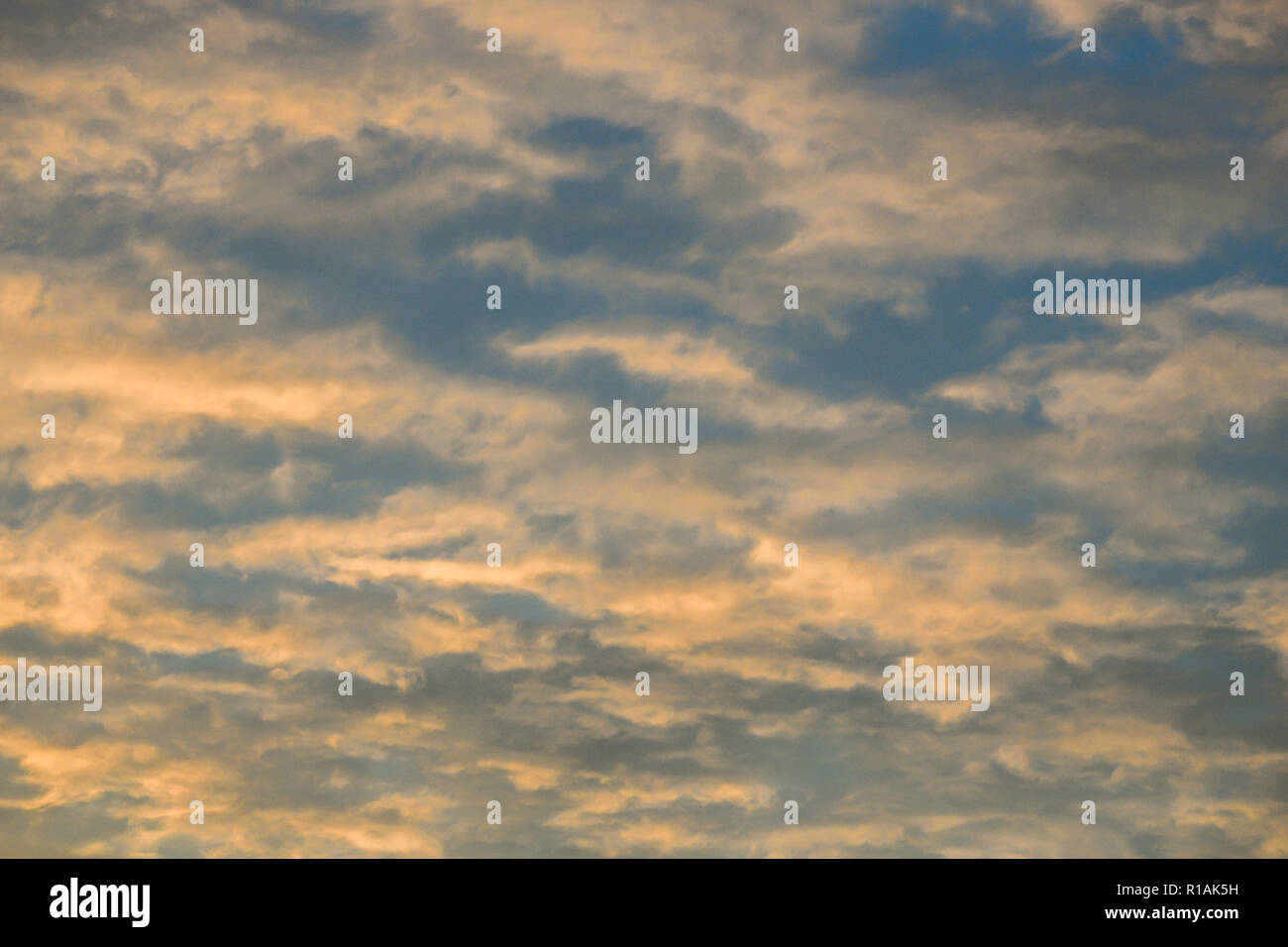 Pink wispy clouds at sunset - Stock Image