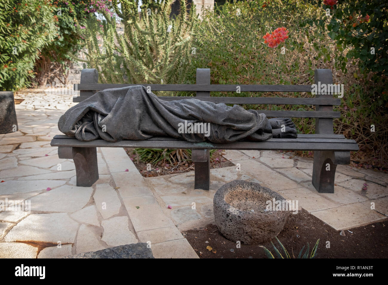A statue of Homeless Jesus on the grounds of the Church of Saint Peter in ancient Caparnaum on the Sea of Galilee, Israel. - Stock Image
