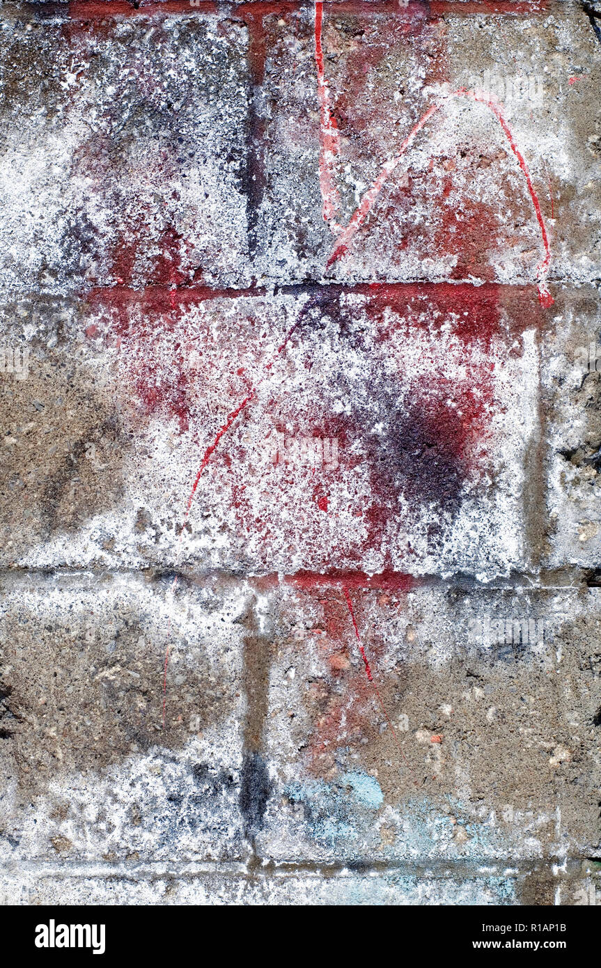 Spray Paint On A Concrete Wall Background Stock Photo