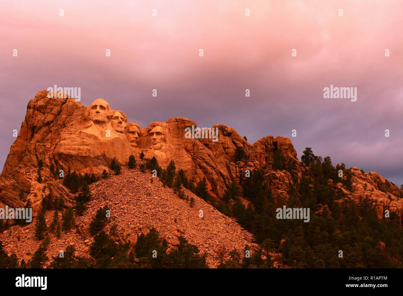 Mount Rushmore in the South Dakota Black Hills National Forest. Summertime with the warm glow of an early evening sun shining on the president's faces Stock Photo