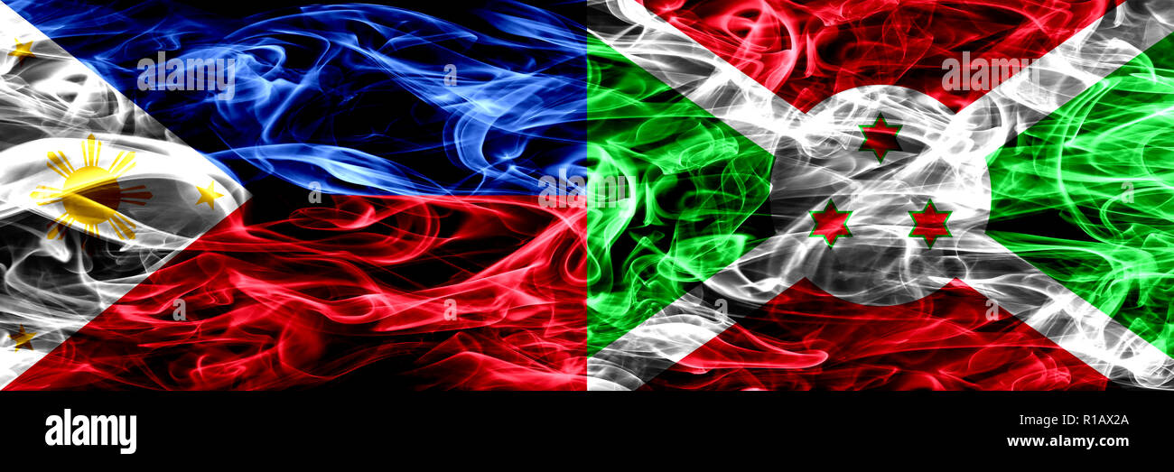 Philippines vs Burundi, Burundian smoke flags placed side by side. Thick abstract colored silky smoke flags Stock Photo