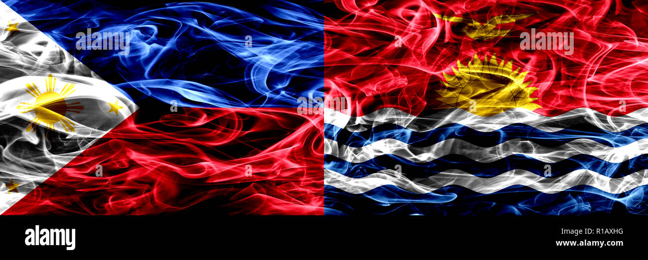 Philippines vs Kiribati smoke flags placed side by side. Thick abstract colored silky smoke flags - Stock Image