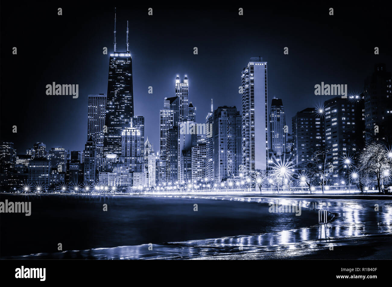 Glowing Chicago Blues Skyline. Iconic view of the Windy City's vibrant downtown from Lakefront Trail at North Avenue Beach along the Gold Coast. - Stock Image