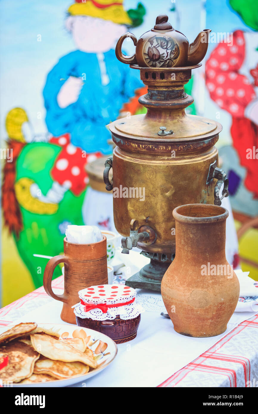 Rustic old cookware with a copper samovar vintage style Stock Photo