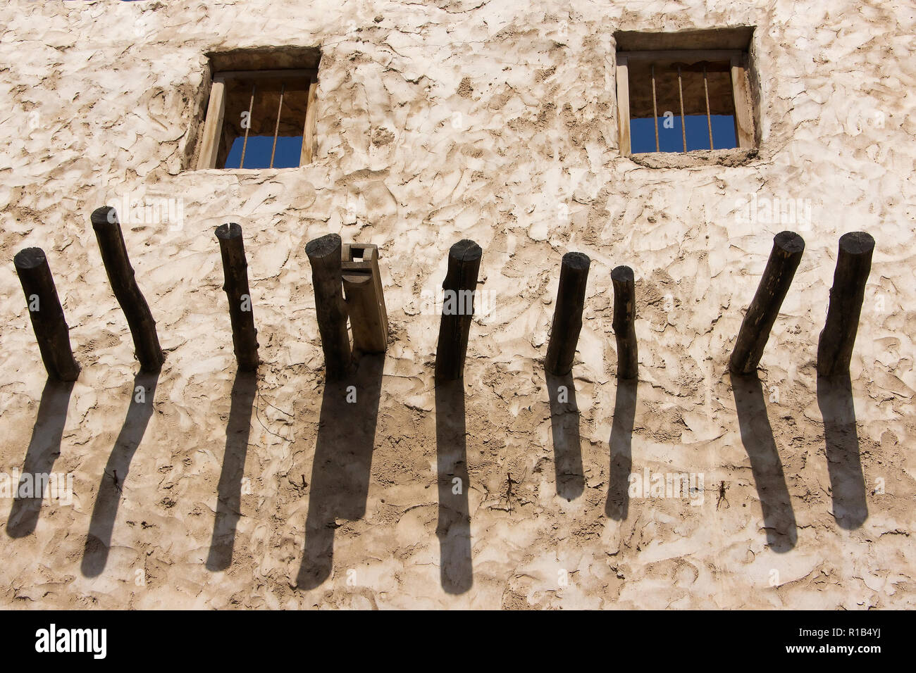 Old arabic house exterior with two windows close up - Stock Image