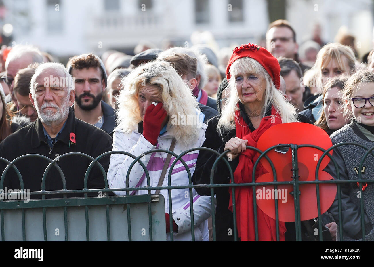 Brighton UK 11th November 2018 - Emotional moments at the Act of Remembrance Service held at Brighton war memorial . It is the 100 year anniversary today of the ending of World War One on the 11th November 1918 . Photograph taken by Simon Dack Credit: Simon Dack/Alamy Live News - Stock Image