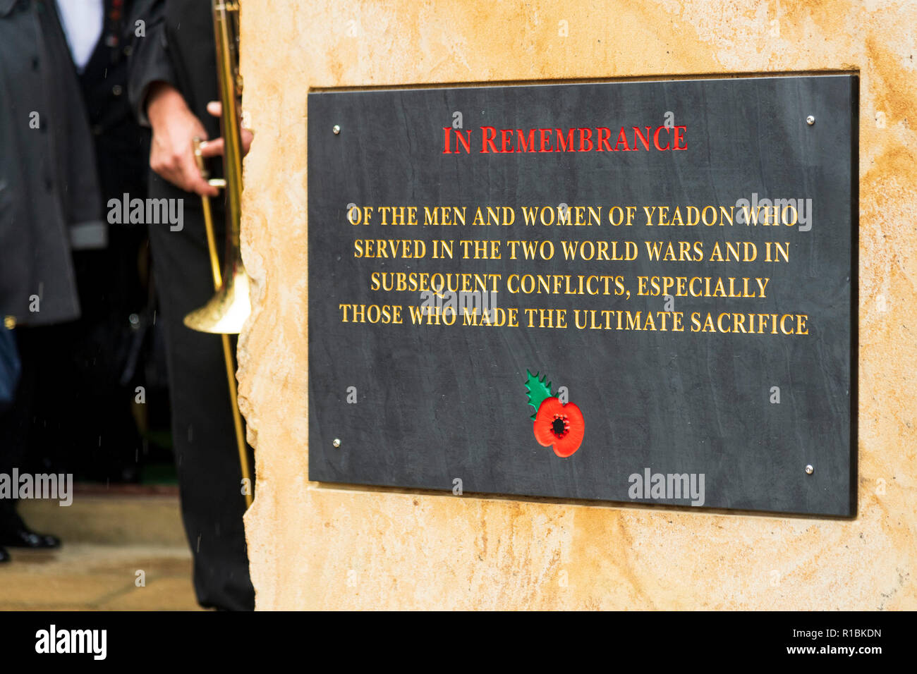 Yeadon, Leeds, West Yorkshire, UK 11th November, 2018. Close-up of the plaque inscription & red poppy motif on the new war memorial stone in front of Yeadon Methodist Church, on the anniversary of the end of the First World War. Ian Lamond/Alamy Live News Stock Photo