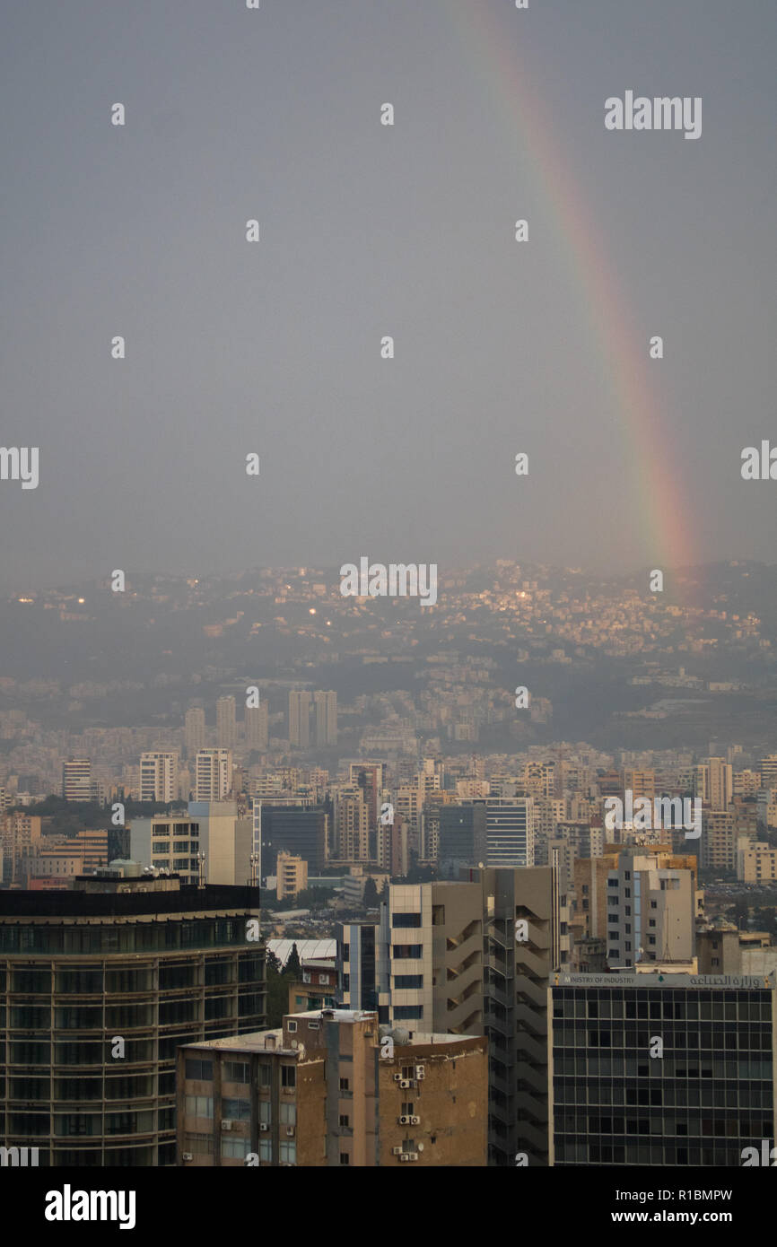 Beirut Lebanon. 11th November 2018.A  rainbow arc appears over downtown Beirut after a rain shower in the Lebanese capital on Armistice Day Credit: amer ghazzal/Alamy Live News - Stock Image