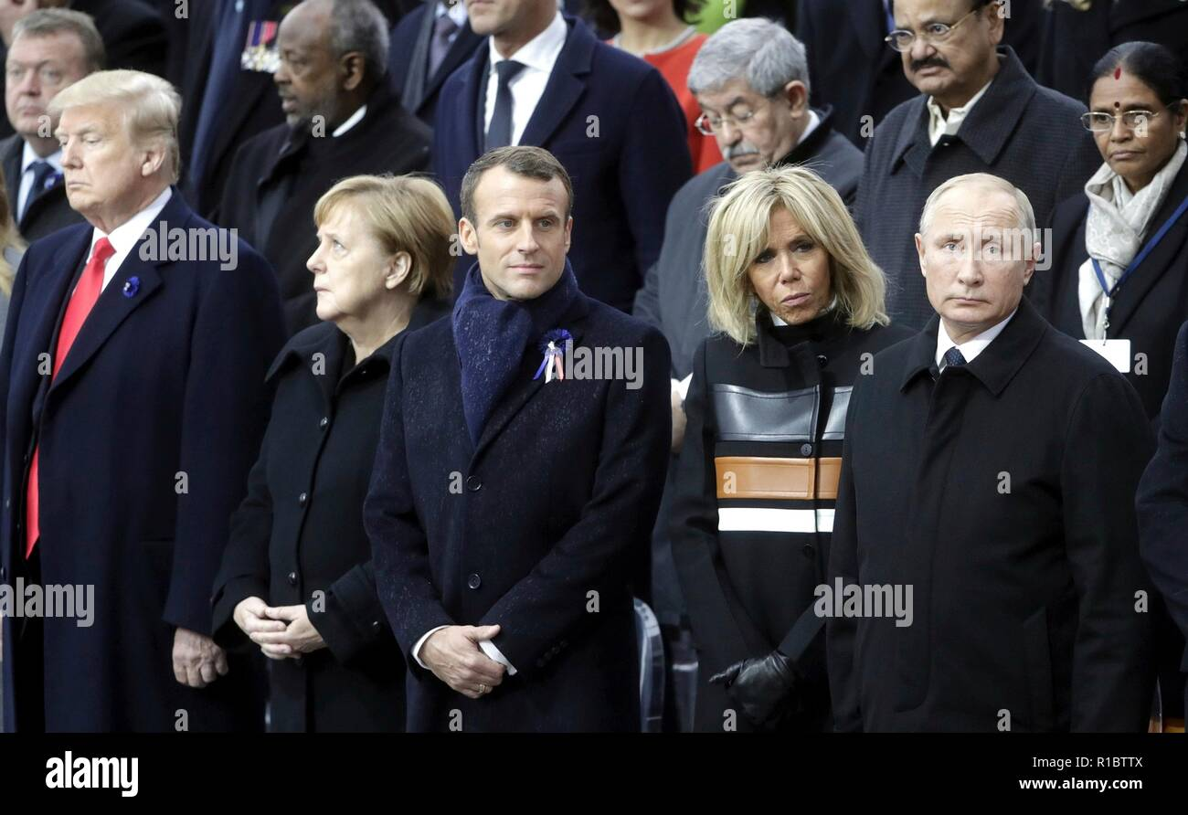Paris, France. 11th Nov 2018. World leaders gathered before the start of events marking the Centennial of Armistice Day at the Arc de Triomphe November 11, 2018 in Paris, France. Standing from left to right in the front row are: U.S. President Donald Trump, German Chancellor Angela Merkel, French President Emmanuel Macron, Brigitte Macron and Russian President Vladimir Putin. Credit: Planetpix/Alamy Live News - Stock Image