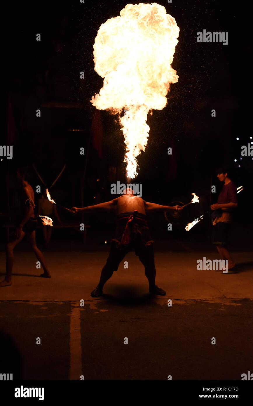 Fire eater showing off his skills in Ayutthaya Historical Park, Ayutthaya, ThailandStock Photo