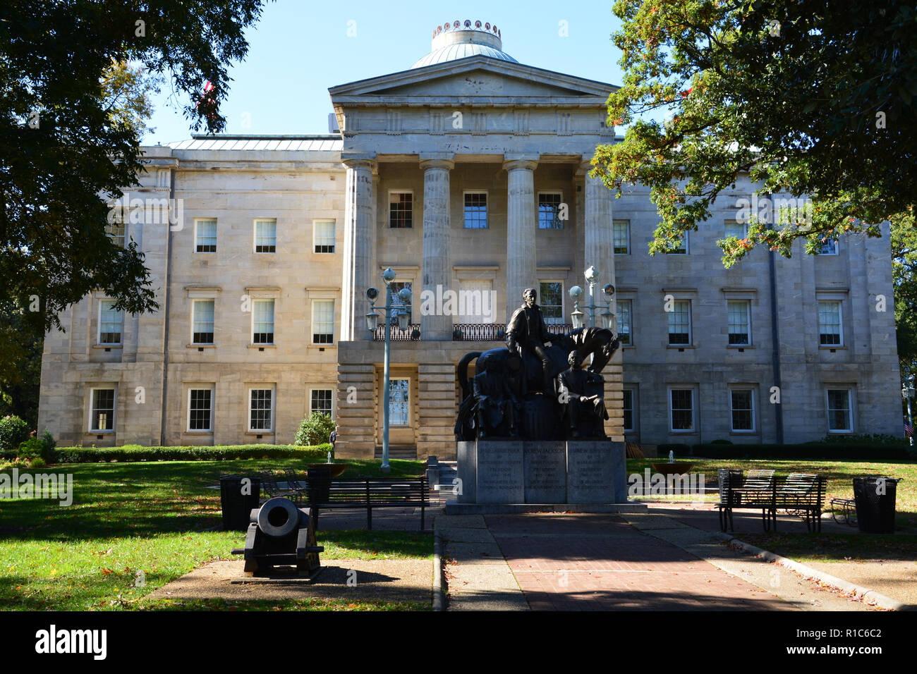The Three Presidents Monument showing Presidents Johnson, Jackson and Polk outside the historic Capitol building in Raleigh North Carolina. - Stock Image