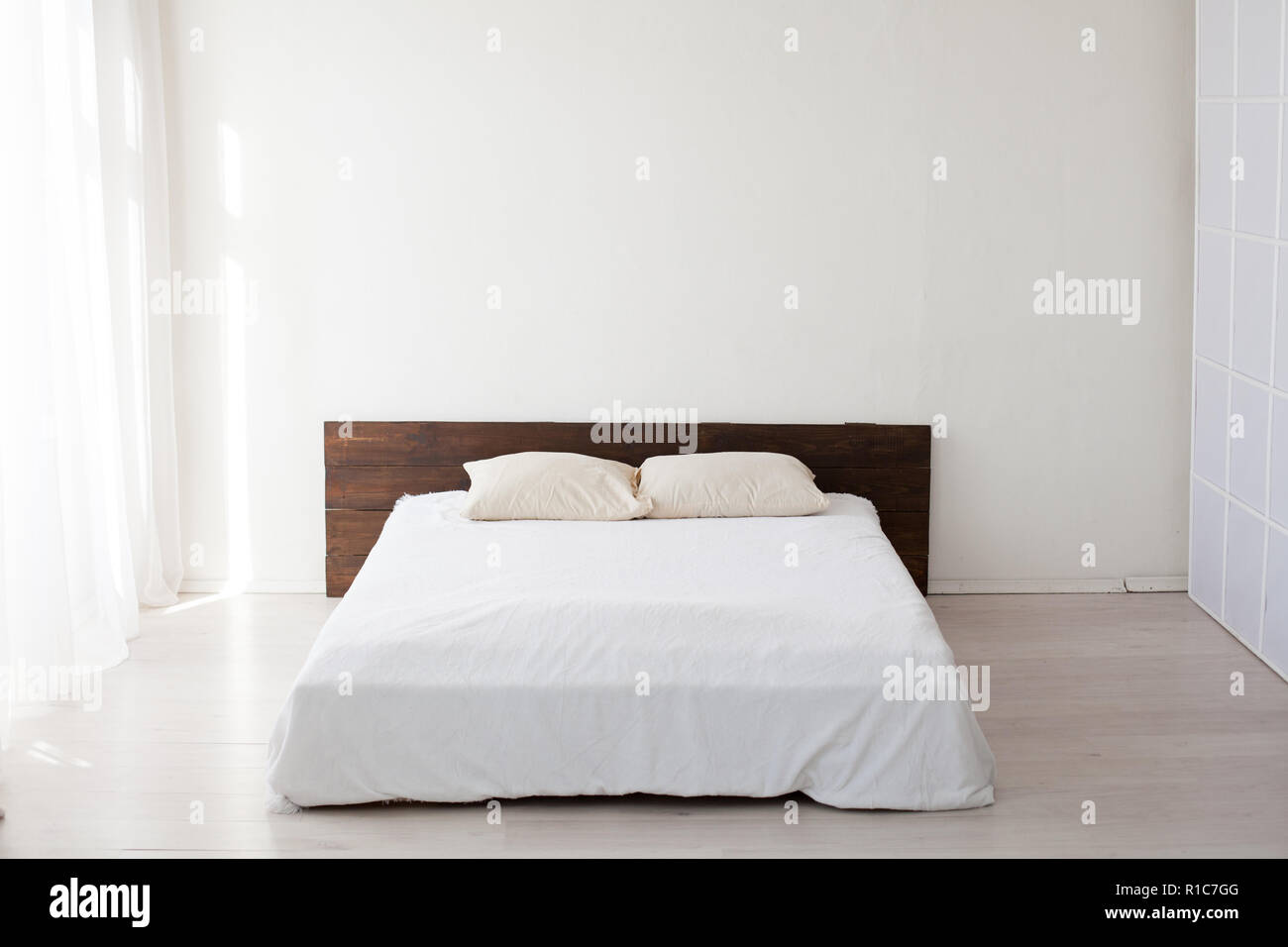 large bed in the Interior white bedrooms Stock Photo ...