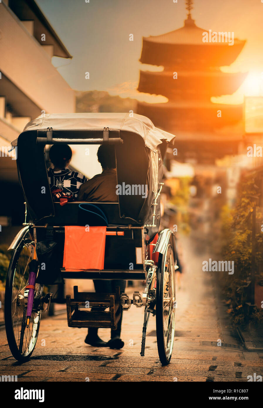 rickshaw in narrow street of yasaka shrine one of most popular traveling destination in kyoto japan - Stock Image