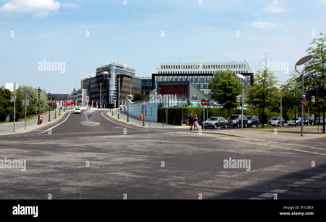 In modern Berlin there are many wide open spaces, modern glass buildings, clean and immaculate thoroughfares which are aesthetically pleasing to the eye as this road junction can testify. - Stock Image