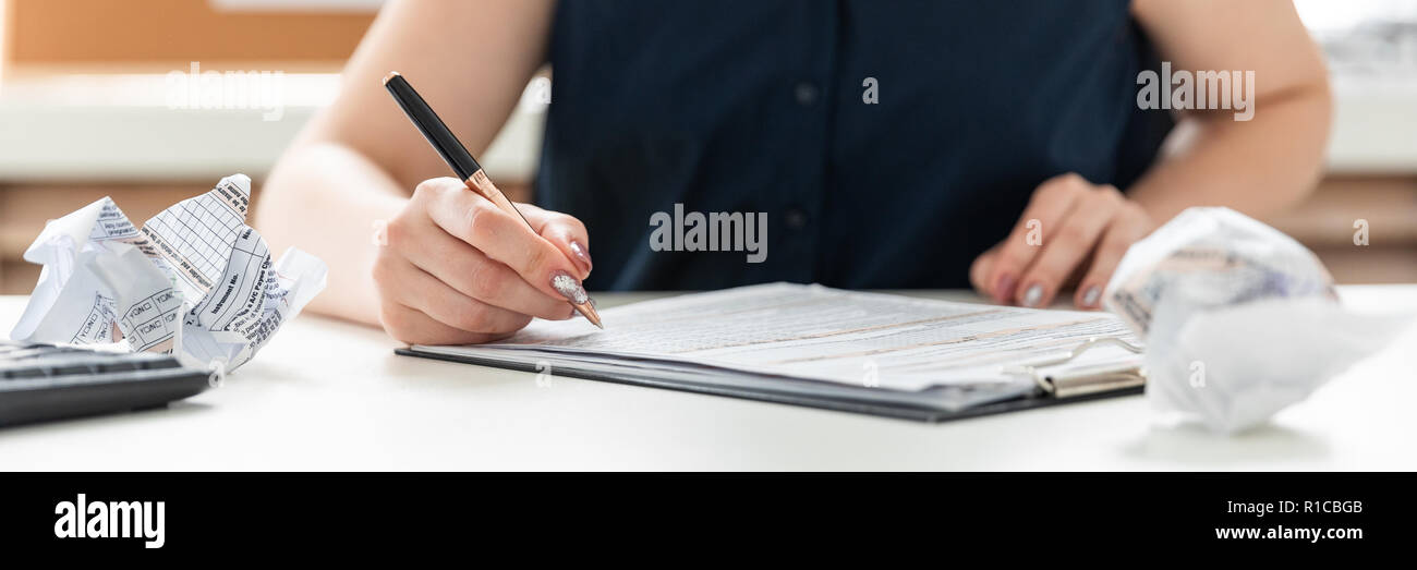 Women's hands fill out a questionnaire. - Stock Image