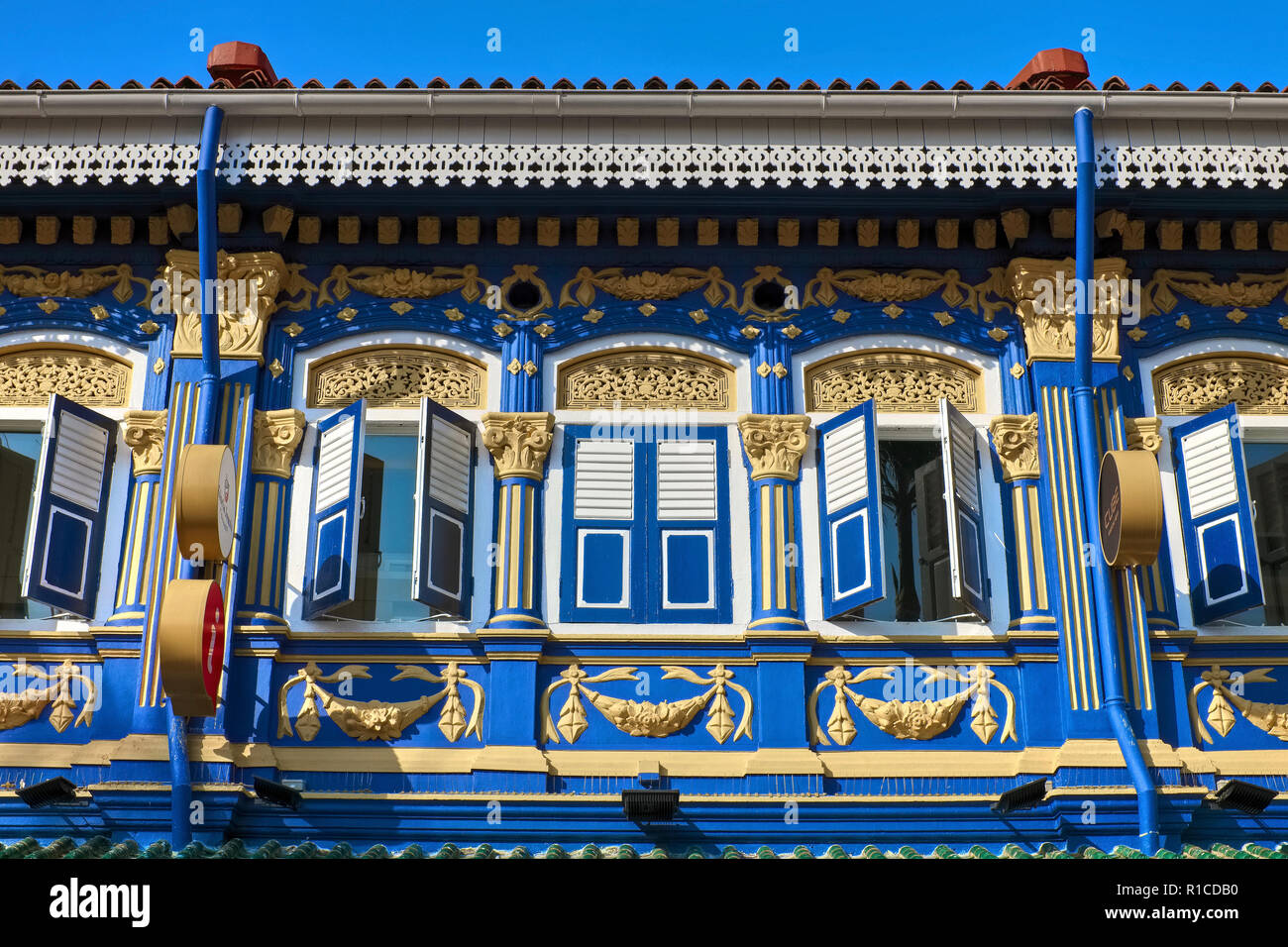 The prettily painted, Peranakan-style facade Cube Boutique Capsule Hotel @ Kampong Glam, near Sultan Mosque, Singapore - Stock Image