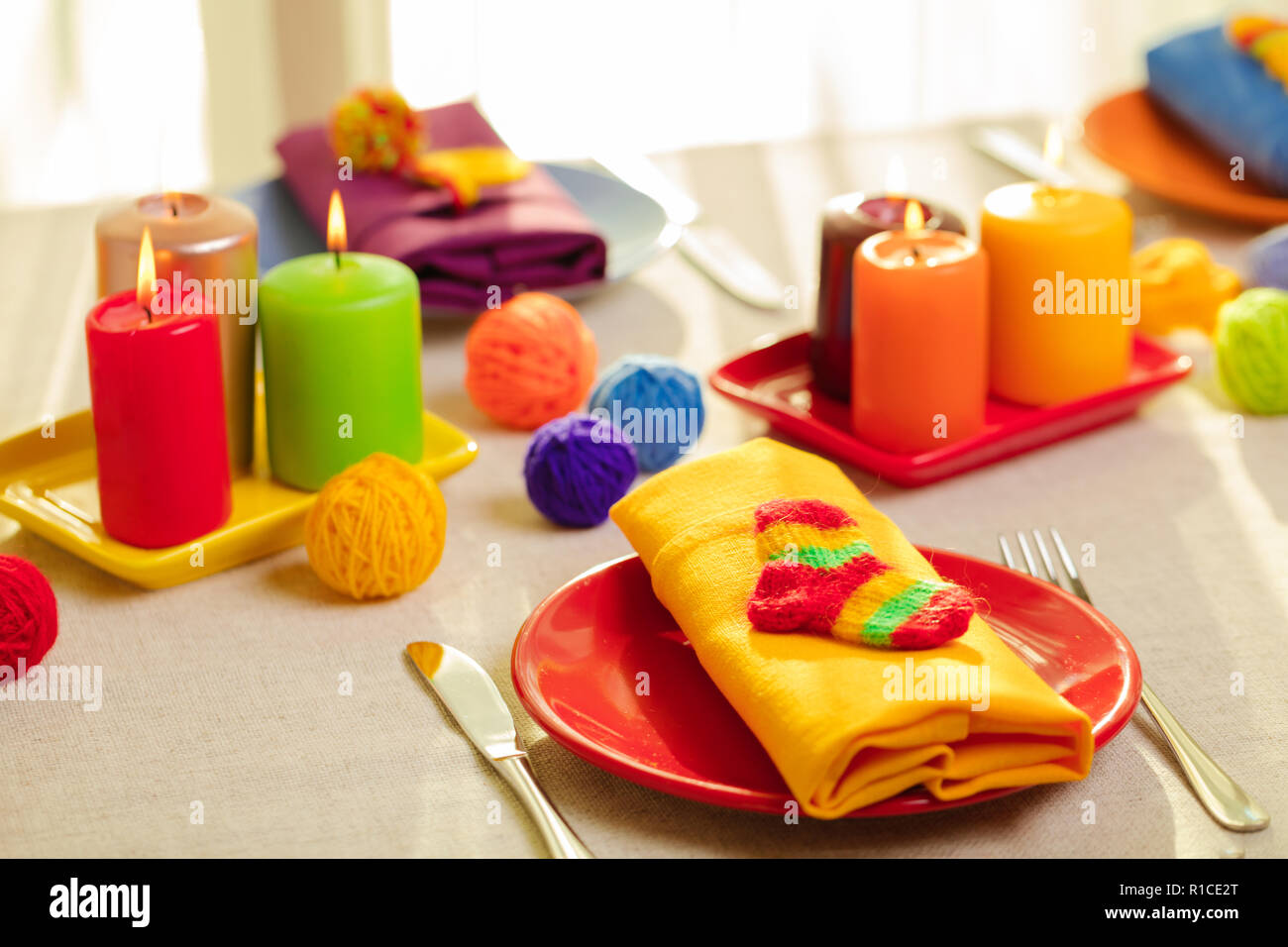 Multicolored Plates And Linen Napkins With Knitted Decor Table Setting For The Autumn Or Winter Cold Season Thanksgiving Halloween Christmas And Stock Photo Alamy