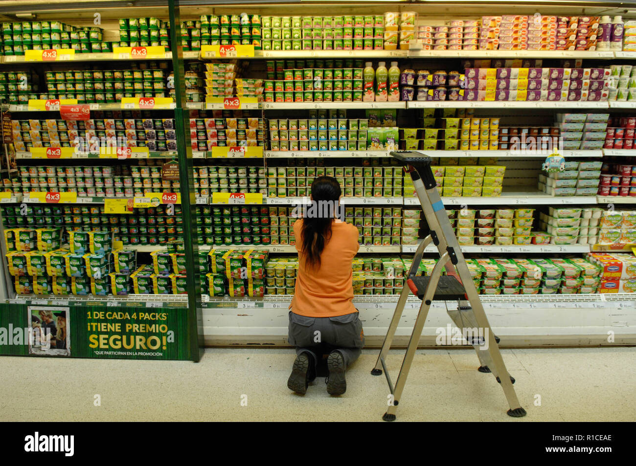Salesgirl arranging products Stock Photo
