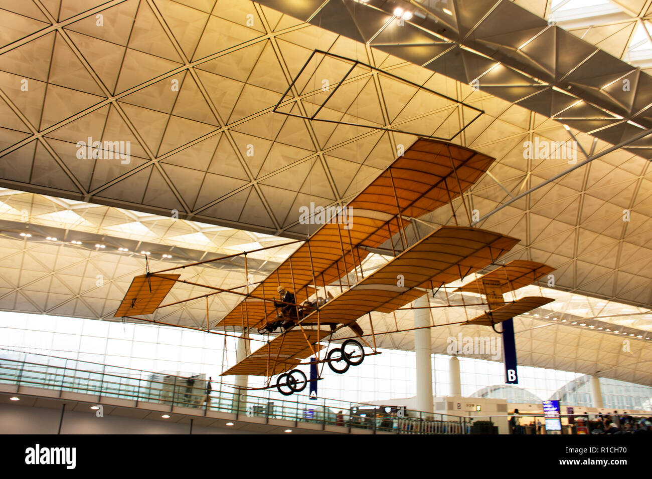 Model of ancient plane hanging on hall pf terminal for show people at Chek Lap Kok or Hong Kong International Airport on September 10, 2018 in Hong Ko - Stock Image