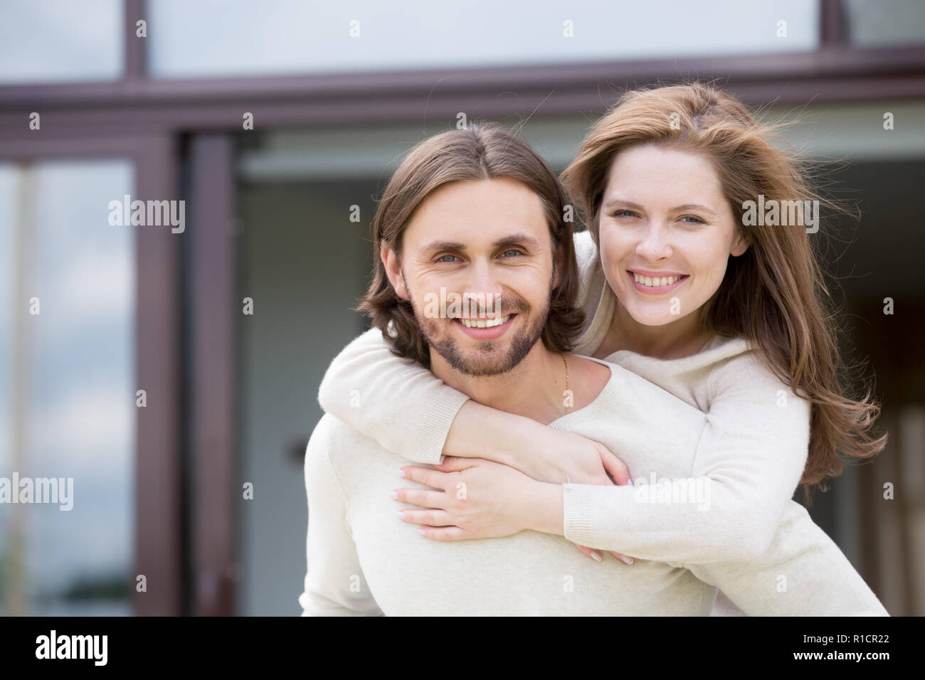 Portrait of attractive smiling married couple outdoors - Stock Image