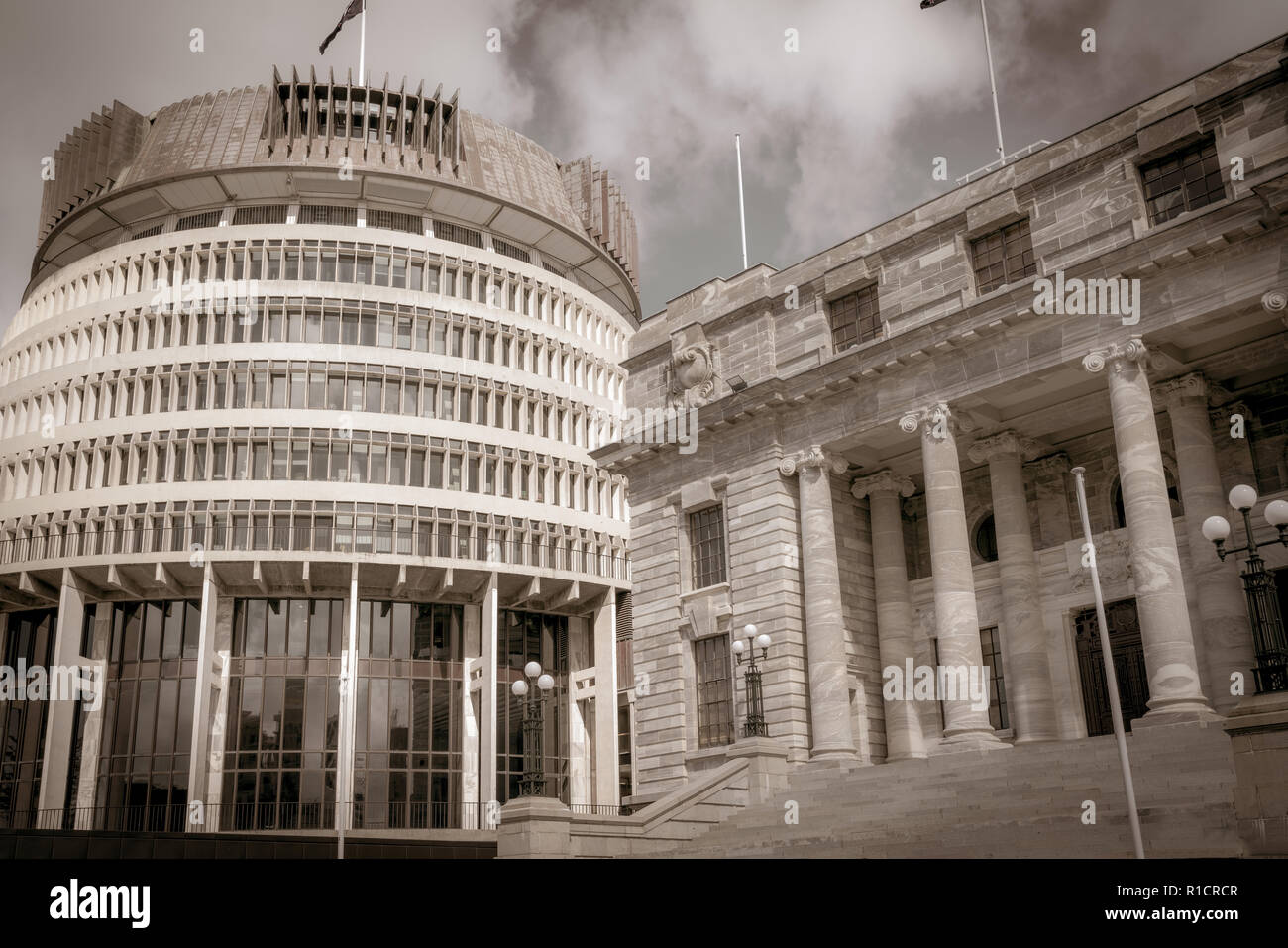 New Zealand Government buildings, House neo classical style House of Parliament with Beehive beside in old-world speia effect - Stock Image