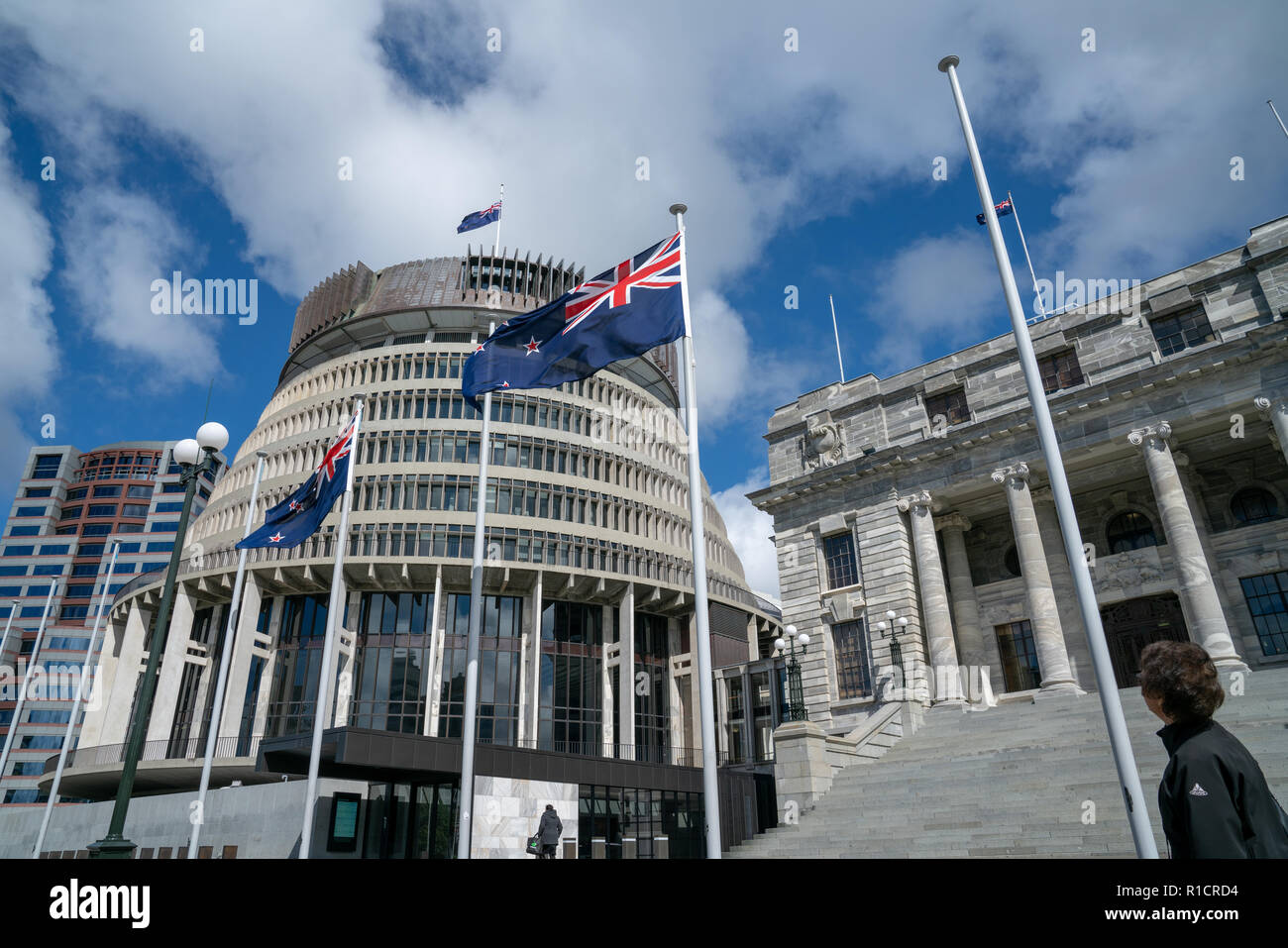 WELLINGTON NEW ZEALAND - OCTOBER 2 2018; Flags flutter in front New Zealand Government buildings, House neo classical style House of Parliament Stock Photo