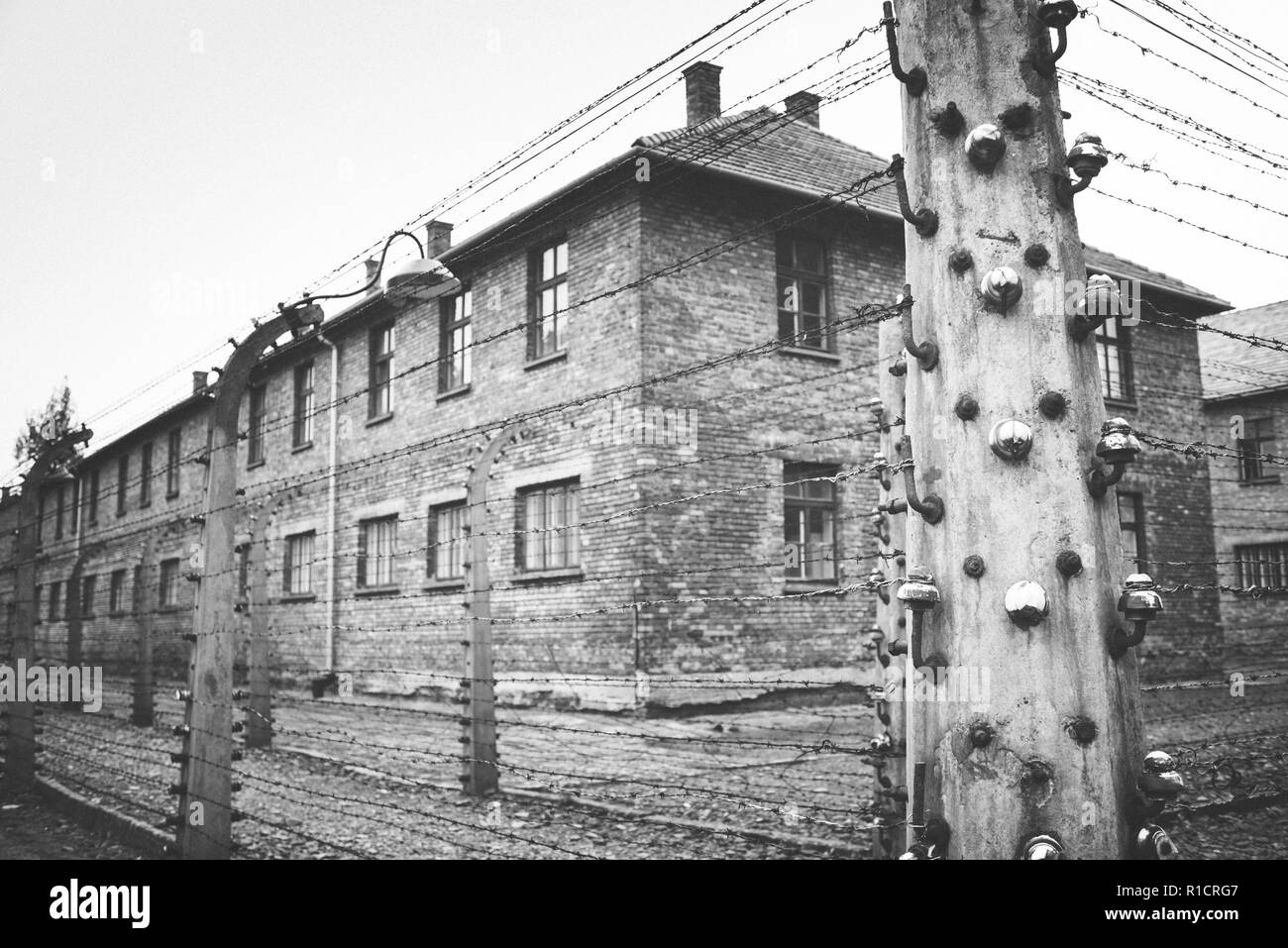 Auschwitz Nazi concentration and extermination camp. Electrified fences. Auschwitz, German-occupied, Poland, Europe - Stock Image