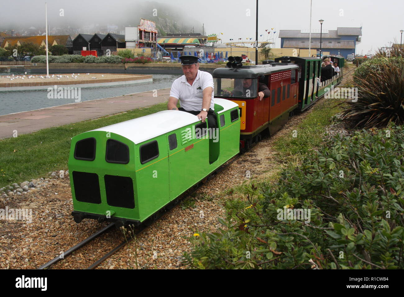 A MINIATURE TRAIN RUNNING AT HASTINGS MINIATURE RAILWAY