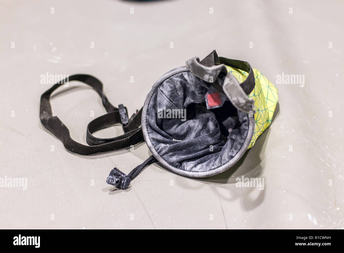 climbing bag for magnesia lies on the mat isolate - Stock Image