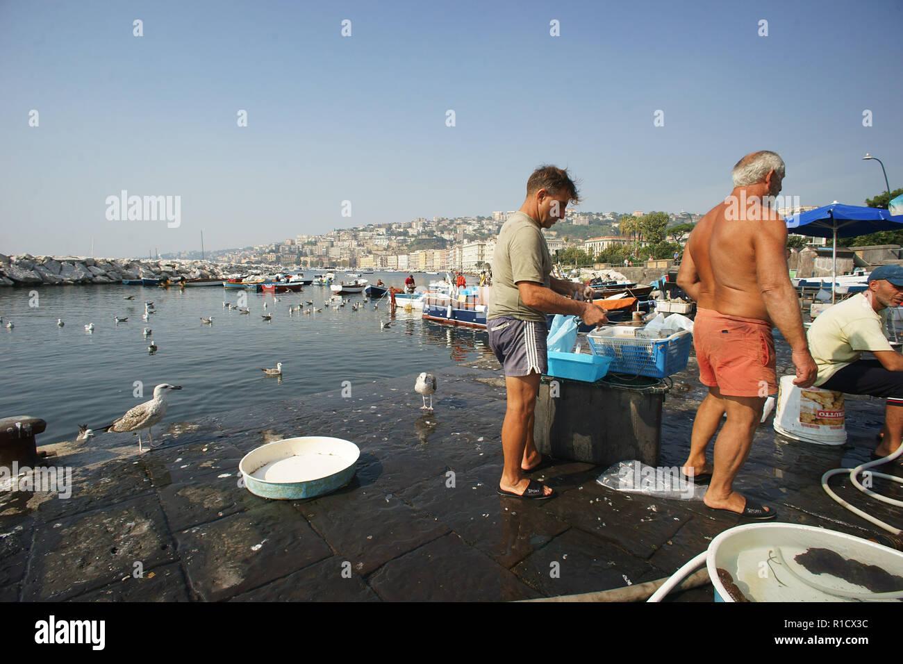Fisherman selling fish, rotonda Diaz, City of Naples, Gulf of Naples, Italy - Stock Image