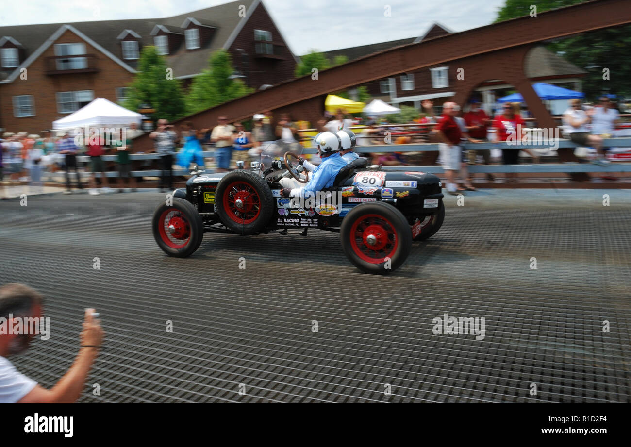 Drivers complete one lap of race in Fairport NY... - Stock Image