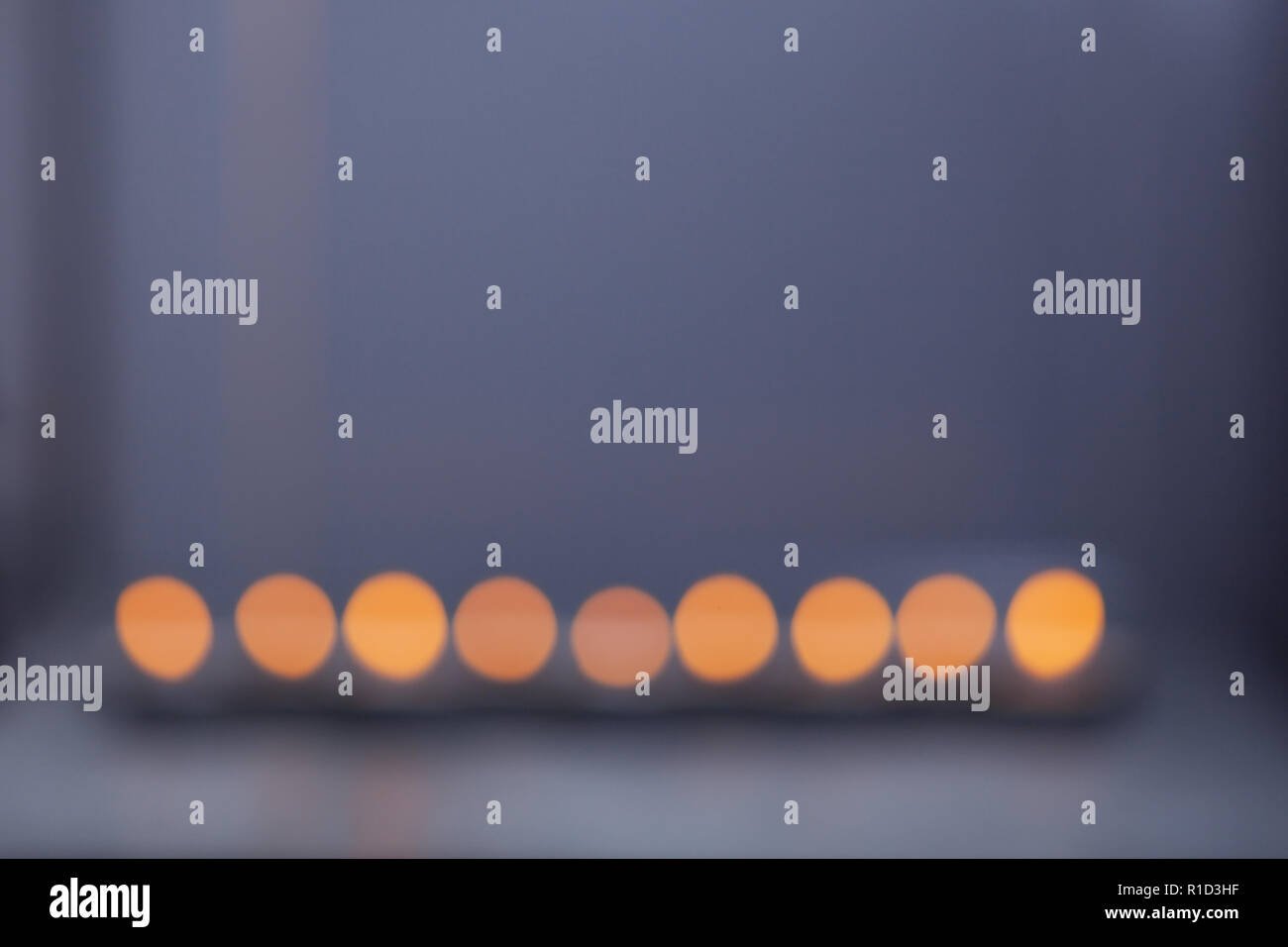 The Defocused lights of Jewish holiday Hanukkah. Stock Photo