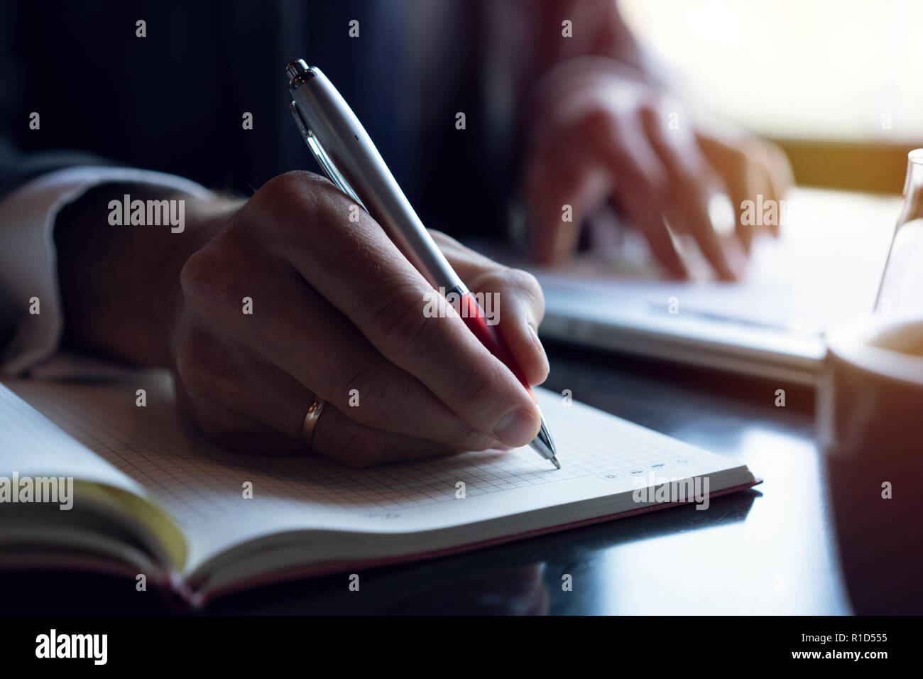 Businessman analyzing investment charts. Accounting. Hands of financial manager taking notes while working. - Stock Image