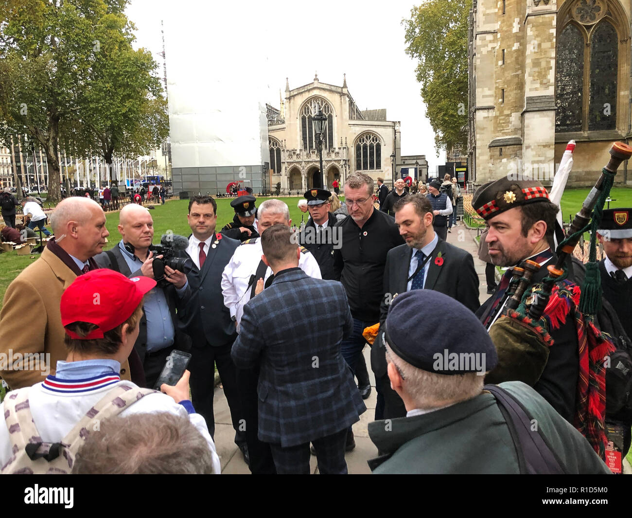 Tommy Robinson, former EDL leader seen speaking during a visit of a memorial for the 100th anniversary of the first World War in London. - Stock Image